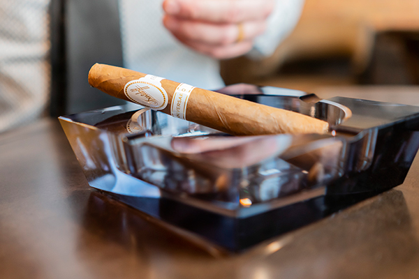 A cigar resting in an ashtray at Chaloner's Cigar House